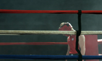 Defeated boxer hangs his head after the fight